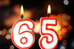 the numbers 65 as candles that are lit