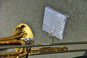 trombone with a musical sheet in front of it
