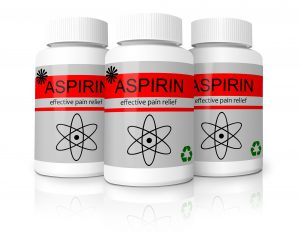 three white pill bottles with the word aspirin on them
