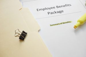 paper in folder that says employee benefits package with a highlighter