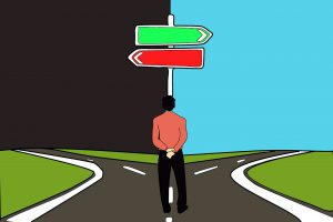 a man standing at a crossroad with one green sign pointing right to daylight and a red sign pointing left to a dark night