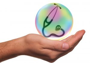 caucasian hand with a bubble over it with a stethoscope in the bubble.