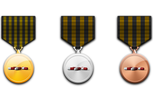 3 medals with medicine pills in the center, one gold, one silver and one bronze