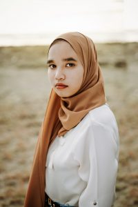 young asian woman with a hijab around her hair and neck