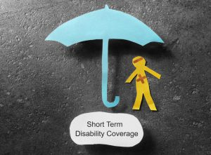 cutout of a person with a blue umbrella over them and short term disability coverage underneath them