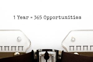 """typewriter with the words """"1 year=365 opportunities"""" written in the middle"""