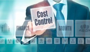 """a man in a suit with his hand on a button that says """"cost control"""""""