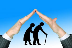 silhouettes of two older people with hands over them touching fingers making a roof