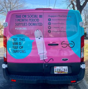 a pink and blue van with information of I support the girls organization