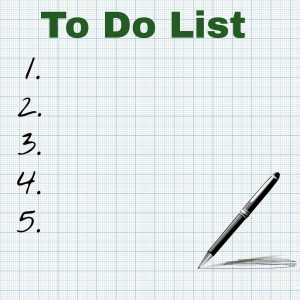 to do list numbered 1 to 5 with a pen on the bottom