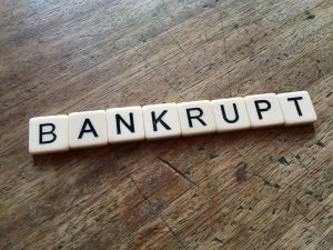bankrupt spelled out in tiles