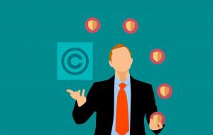 illustration of a man with a suit juggling shields and a copyright logo