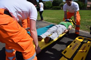 man on a stretcher with two fireman carrying him