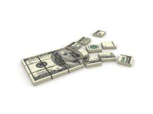 hundred dollar bill broken down into pieces