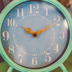 teal clock with the little hand on 10 and the big hand on 2
