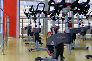 elliptical machines lined up in a gym