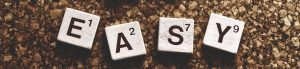 the word easy spelled out in scrabble letters