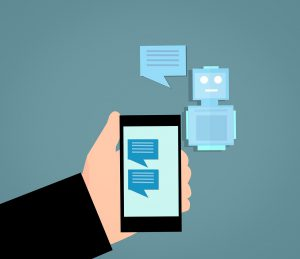 illustration of a hand holding a cell phone with a chat on the screen and a robot next to the phone with a chat box