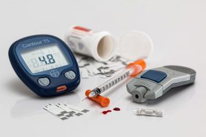 diabetes glucose checker and a needle with strips