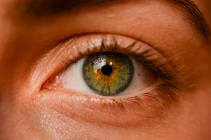 a woman's eye that is green in color