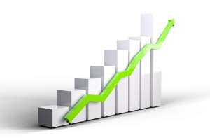graph with bars going upward and a green arrow going up