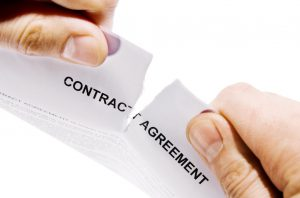 contract agreement being ripped in half