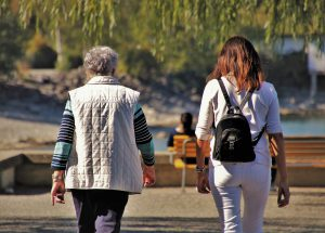 older womana nd a younger woman walking together