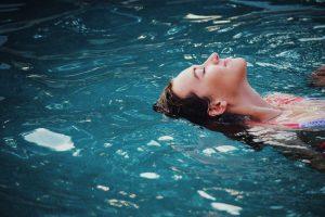 caucasian woman floating in water