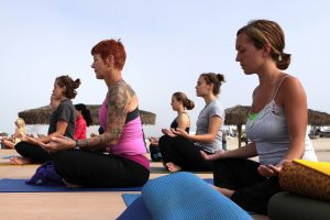 group of women doing yoga outside