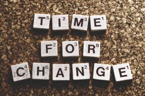 time for change written with scrabble letters