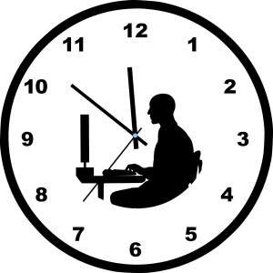 clock with silhouette of a person sitting at a desk in front of a computer inside of it