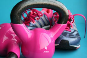 pink kettle bells with sneakers in the background