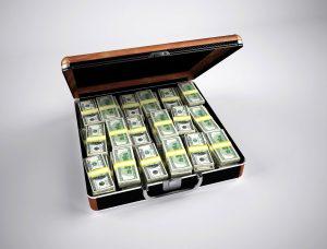 suitcase full of money stacks