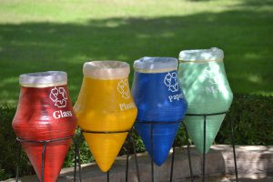 4 different colored recycling bins