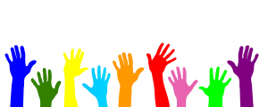 different colored hands up in the air next to each other.