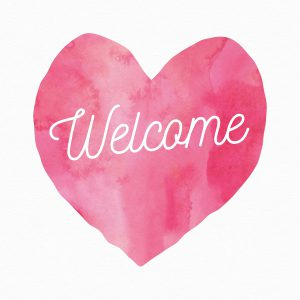 the word welcome in a pink heart