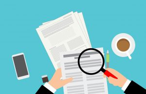 illustration of hand with magnifying glass looking at documents