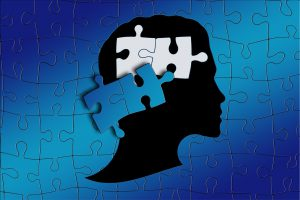 puzzle of a person's head with two pieces missing.