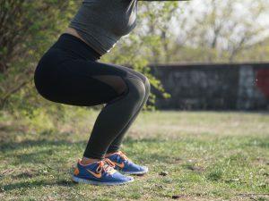 woman squatting outside