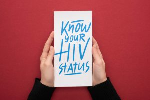 know your HIV status written on a piece of paper