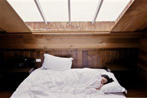 woman sleeping in a big bed