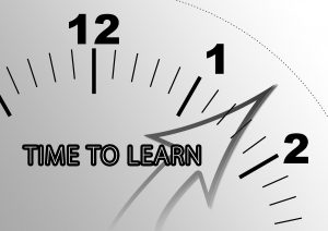 """clock with the words """"time to learn"""" on it"""
