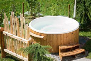 white hot tub with wood panels around it